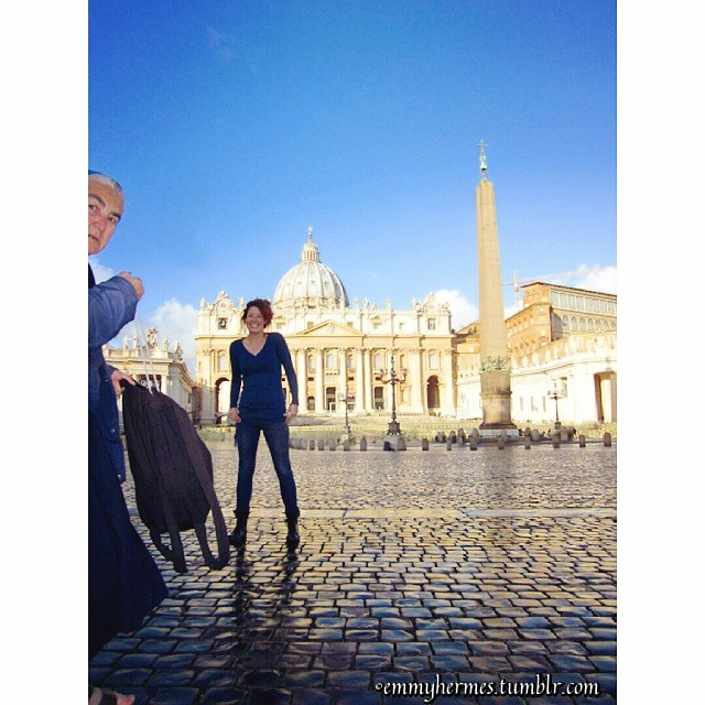 Rome - Emmy in front of St. Peters getting photo bombed by a Nun